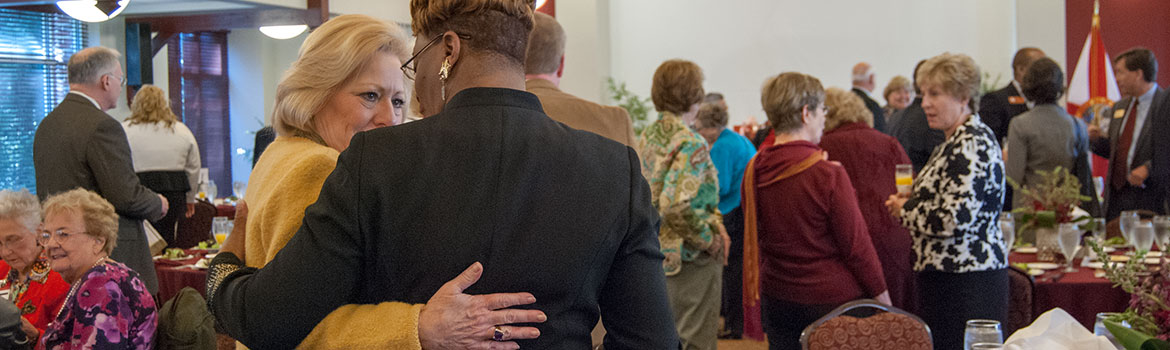 Image of two women hugging at a donor event