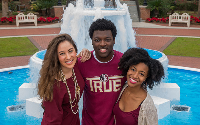 Photo: Students smiling at Westcott fountain