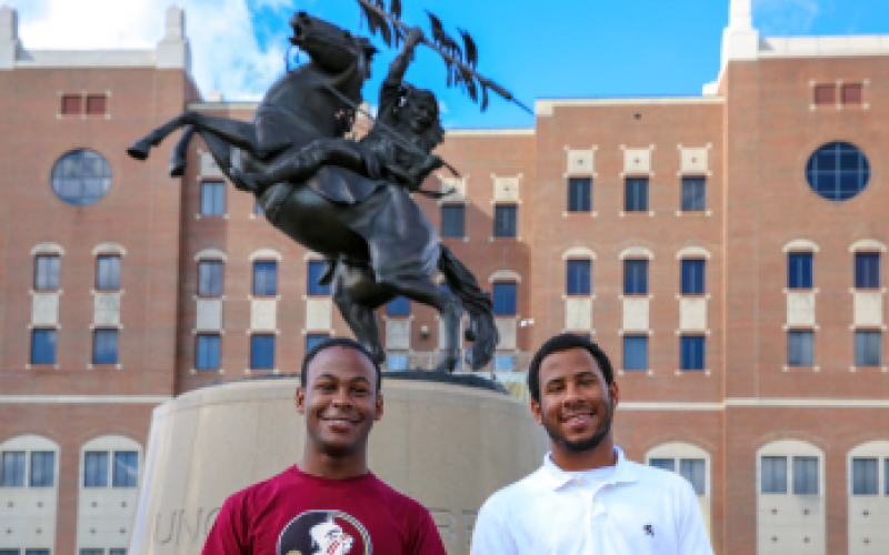 Students in Unconquered Scholars posing for pictures