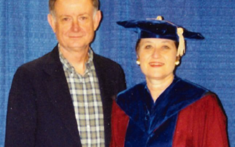 Jay and Dr. Sue Newman posing at her graduate ceremony