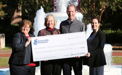 General Mills check presentation infront of the Westcott fountain on FSU's campus