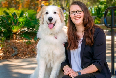 Photo of Ellen Cecil-Lemkin with her dog