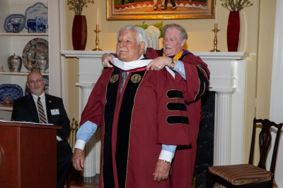 President Thrasher bestowing the honorary stole on Dr. Hold