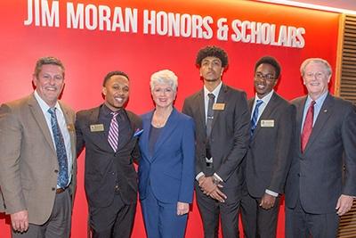 Photo of Randy Blass, Jan Moran, President John Thrasher with Jim Moran Scholars Hakeem Hunter, Robel Mechal and Jerry Jean-Pierre