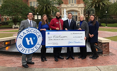 check presentation in front of FSU's Westcott Fountain