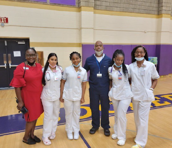 Dr Shelly and students smiling