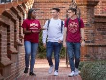 Three FSU students walking and talking