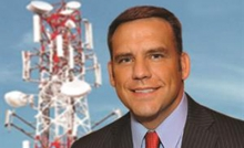 Photo of Steve Mudder with tower in background