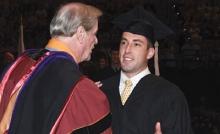 Max Rieves shaking FSU President John Thrasher's hand at graduation